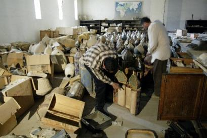 Damaged Ancient Torah Scrolls of Baghdad's magnificent new Saddam Hussein Historical Museum